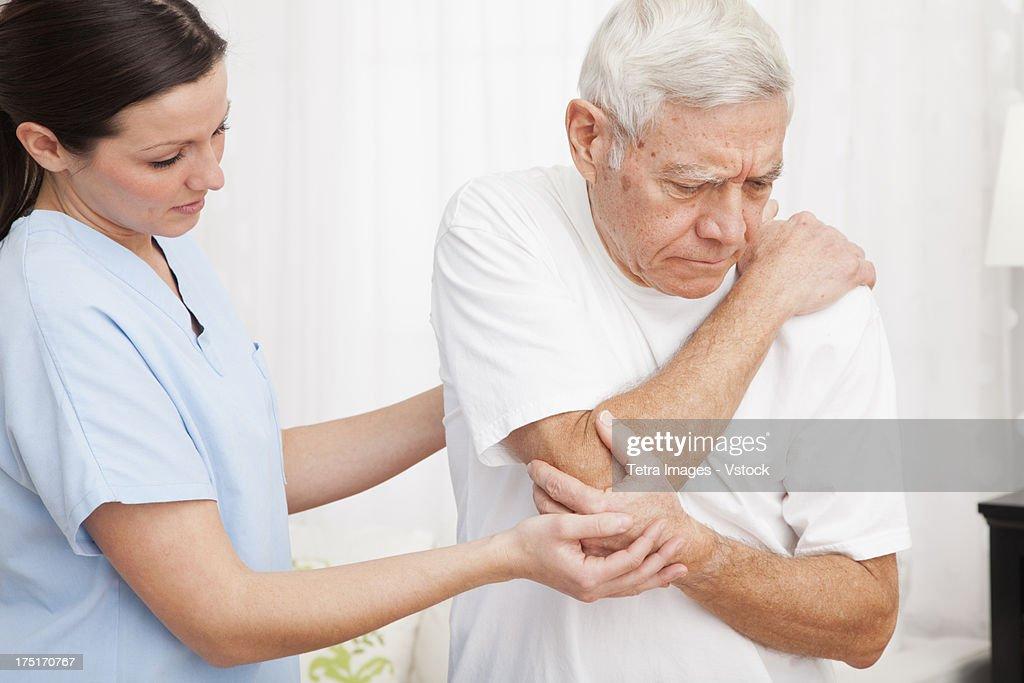 Nurse helping patient : Stock Photo
