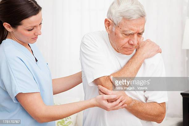 Nurse helping patient
