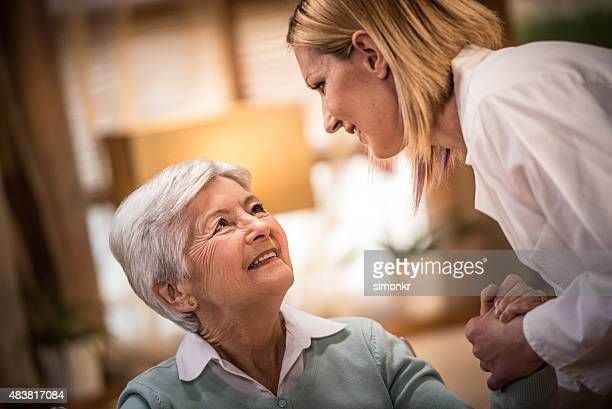 Nurse helping senior woman
