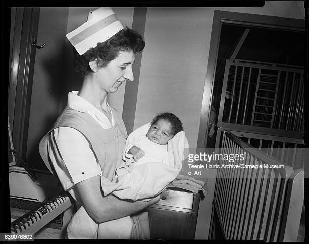 Nurse holding abandoned infant 'Suzanne X' in hospital nursery of Allegheny General Hospital between January and February 1954