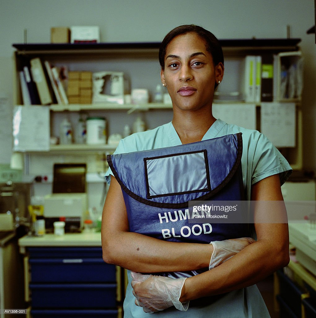 Nurse holding blood bag : Stock Photo