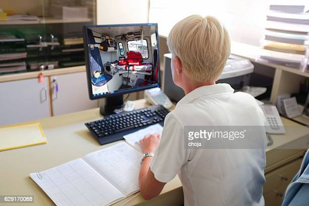 Nurse in her office,working with computer