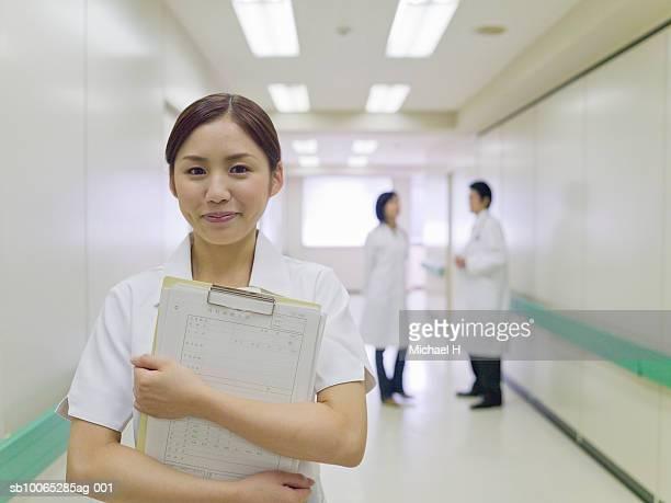 Nurse in hospital corridor, portrait