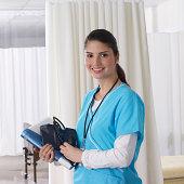 Nurse in ward holding medical notes