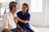 Nurse Making Home Visit To Senior Man For Medical Exam