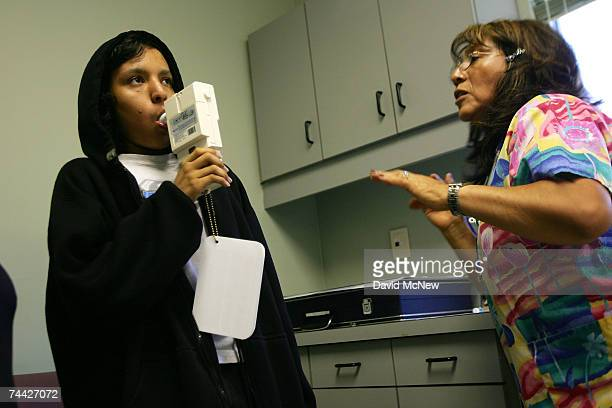 Nurse Maria Aguilar encourages 15yearold Jesus Ayala to exhale hard during a spirometry test of his lung capacity at the Venice Family Clinic on June...