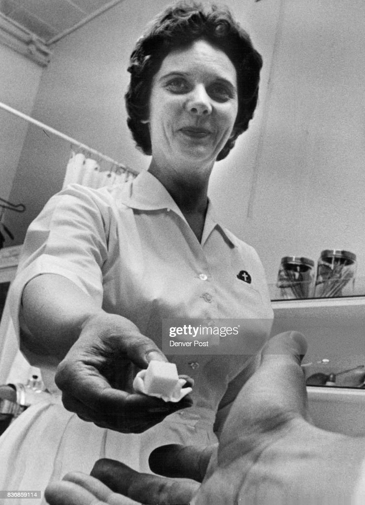 Nurse Nina Koogle Hands out Sugar Cube It Contains two drops of Sabin Oral Polio Vaccine Credit: Denver Post