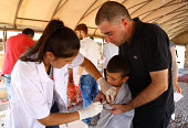 A nurse of Turkish Ministry of Health's Community Health Care Foundation vaccinates an Iraqi Yezidi kid escaping from attacks of Islamic State at a...