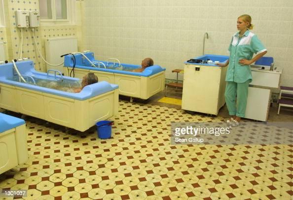 Nurse Petra Jasickova watches over patients taking a mineral water massage August 7 2002 in the spa town of Marianske Lazne Czech Republic Marianske...