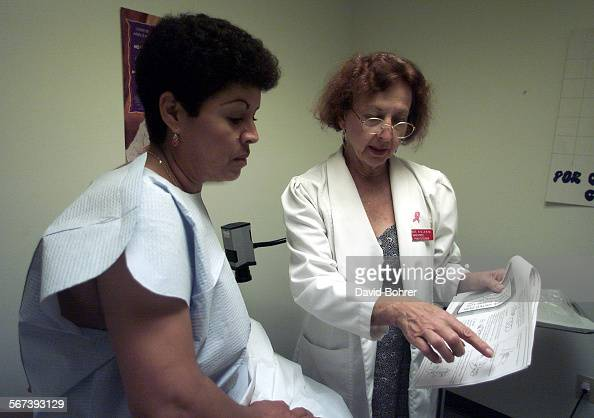 Nurse practitioner Joan Magit talks with patient Robertina Perez of Pacoima during an appointment for a breast examination at the MEND facility in...