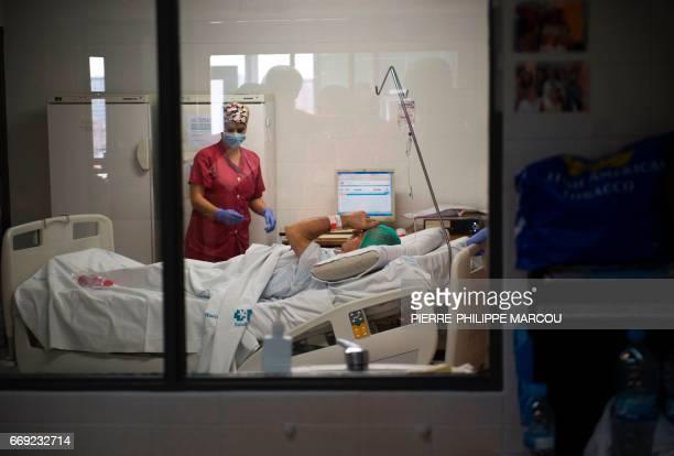 A nurse prepares patient Juan Benito Druet for a renal transplantation at La Paz hospital in Madrid on February 28 2017 Doctors in Spain performed...