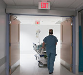 Nurse pushing patient into surgery.