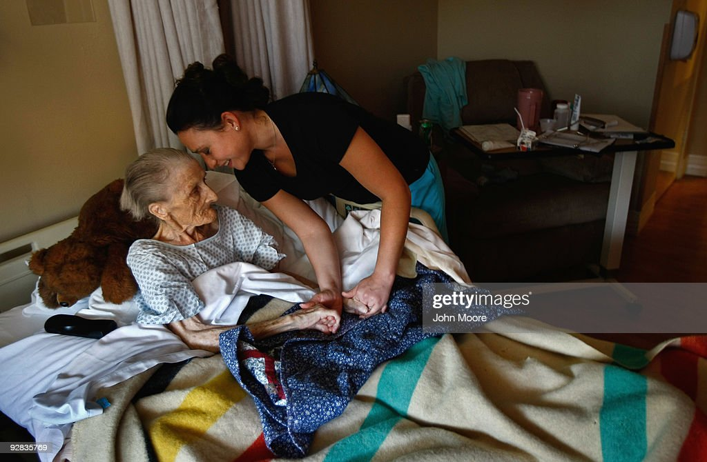 Nurse Rachel Haenel embraces terminally ill patient Jackie Beattie, 83, at the Hospice of Saint John on November 5, 2009 in Lakewood, Colorado. The non-profit hospice accepts patients regardless of their ability to pay, although most are covered by Medicare or Medicaid. End of life care has become a contentious issue in the current national debate on health care reform.