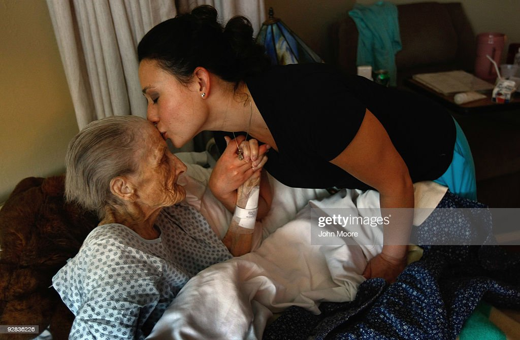 Nurse Rachel Haenel kisses terminally ill patient Jackie Beattie, 83, at the Hospice of Saint John on November 5, 2009 in Lakewood, Colorado. The non-profit hospice accepts patients regardless of their ability to pay, although most are covered by Medicare or Medicaid. End of life care has become a contentious issue in the current national debate on health care reform.