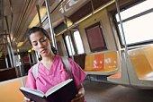 Nurse reading on train