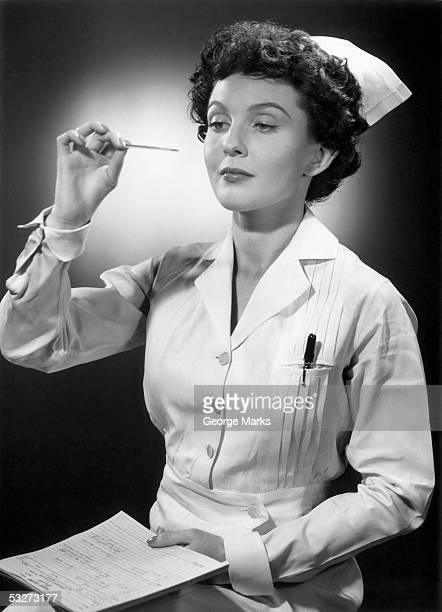 Nurse reading thermometer