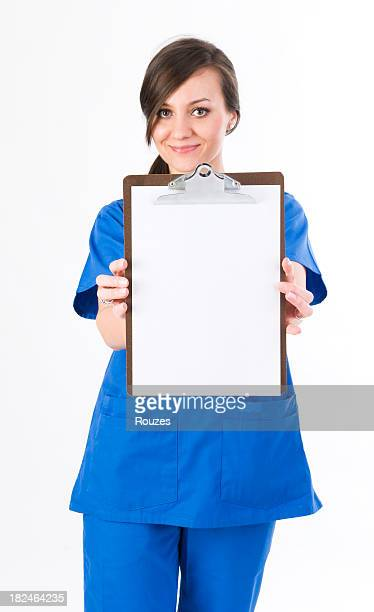 Nurse showing blank clipboard