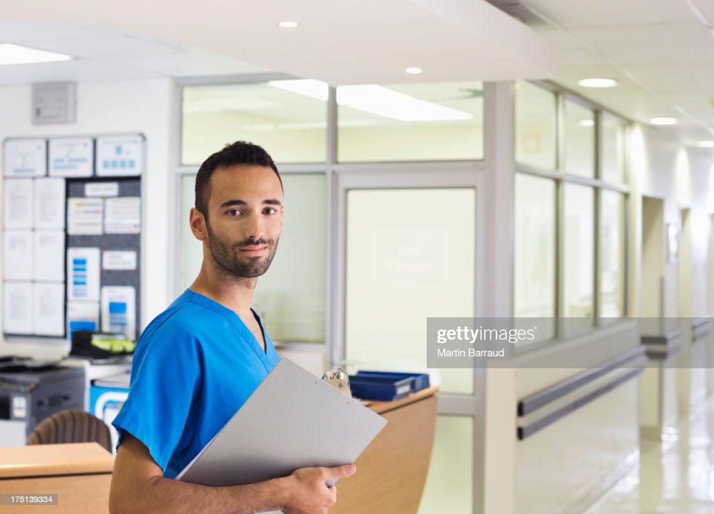 Nurse smiling in hospital hallway