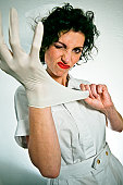 nurse snapping on rubber glove