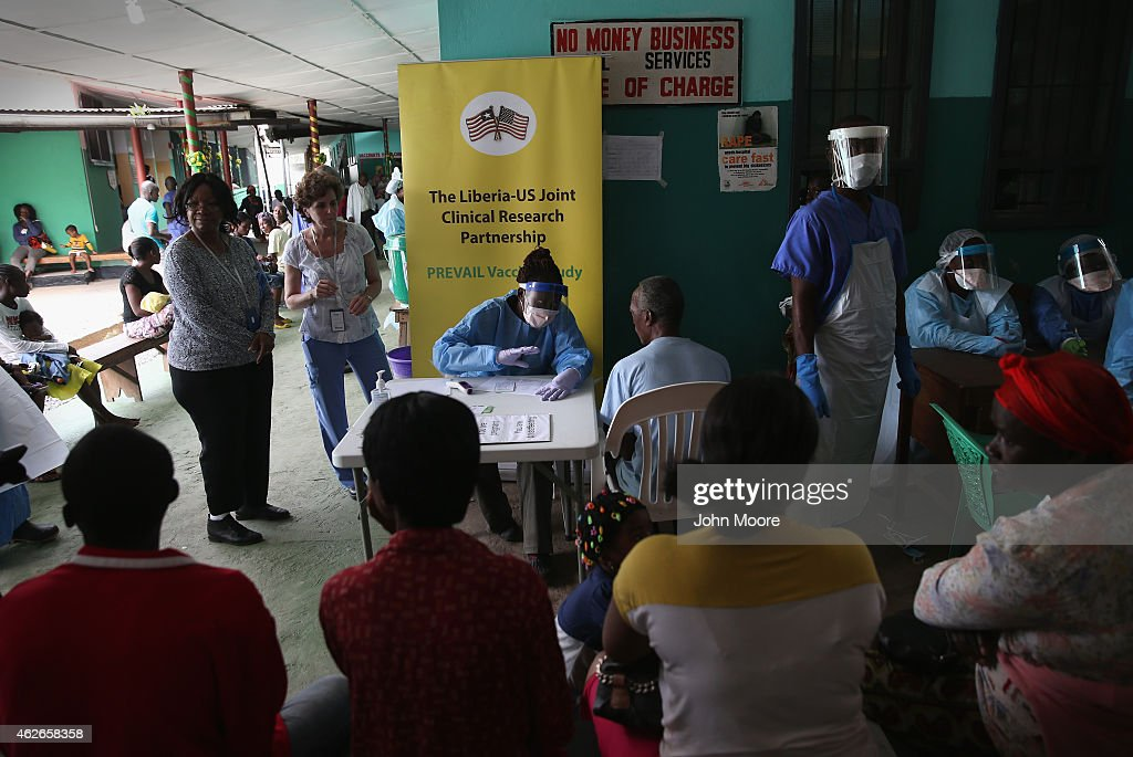 A nurse speaks with a participant in the Ebola vaccine trials which were launched at Redemption Hospital formerly an Ebola holding center on February...