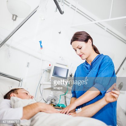 Nurse And Iv Bag Stock Photos and Pictures | Getty Images