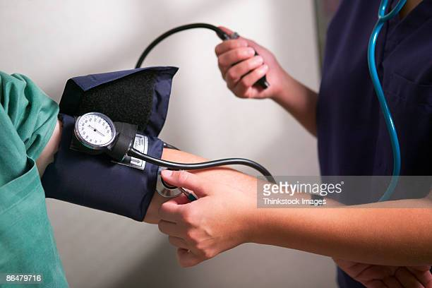 Nurse taking patients blood pressure