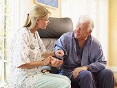 Nurse Taking Patients Pulse