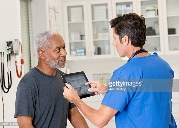 Nurse talking to patient in doctor's office
