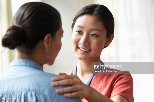 Nurse talking to patient in office