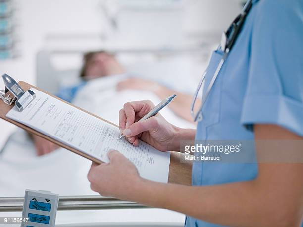 Nurse tending patient in intensive care