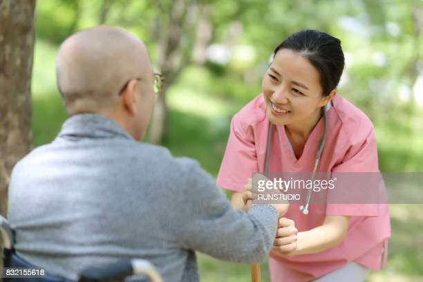 nurse trying to help an old man