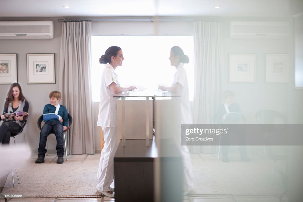 Nurse waiting at hospital reception desk