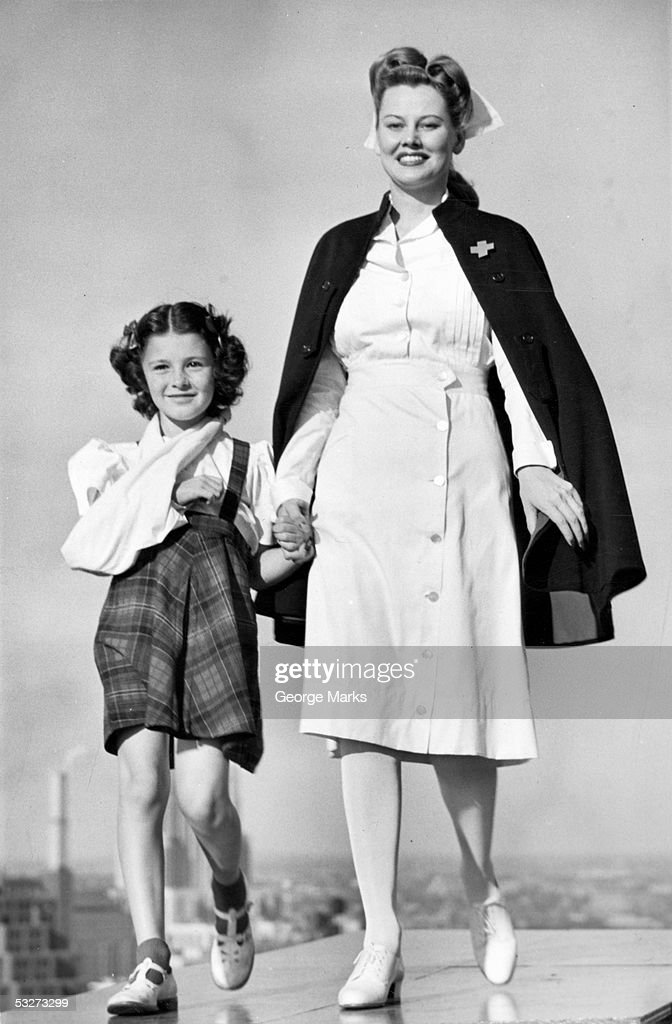 Nurse walking with girl : Stock Photo