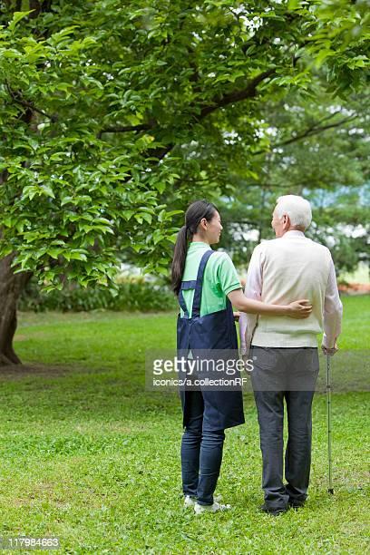 Nurse Walking with Senior Man