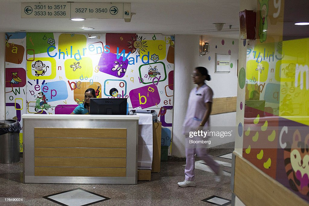 A nurse walks by a service counter in a children's ward of the Indraprastha Apollo Hospitals facility, operated by Apollo Hospitals Enterprise Ltd., in New Delhi, India, on Wednesday, July 19, 2013. Prathap C. Reddy, the cardiologist who built the Apollo hospital chain valued at $2 billion over three decades in India, says hes seeking growth overseas as the nations visa policies drive medical tourists to rivals. Photographer: Prashanth Vishwanathan/Bloomberg via Getty Images