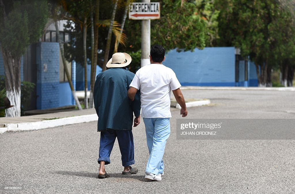 A nurse walks with a patient at the Carlos Federico Mora Mental Health Hospital where following a court order former Guatemalan dictator retired...