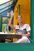 Nurse waving from cafe