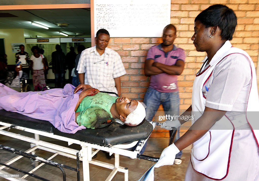 A nurse wheels a survivor, Kasashi Chimbini 22, to the TC X-ray section at the University Teaching Hospital (UTH) in Lusaka. 17 passengers died while four survived when a Lusaka bound passenger service mini bus collided with an oncoming truck. The accident is believed to be caused by a burst tyre, Chisamba on April 30, 2013. APF