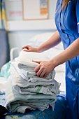 Nurse with clean bedding