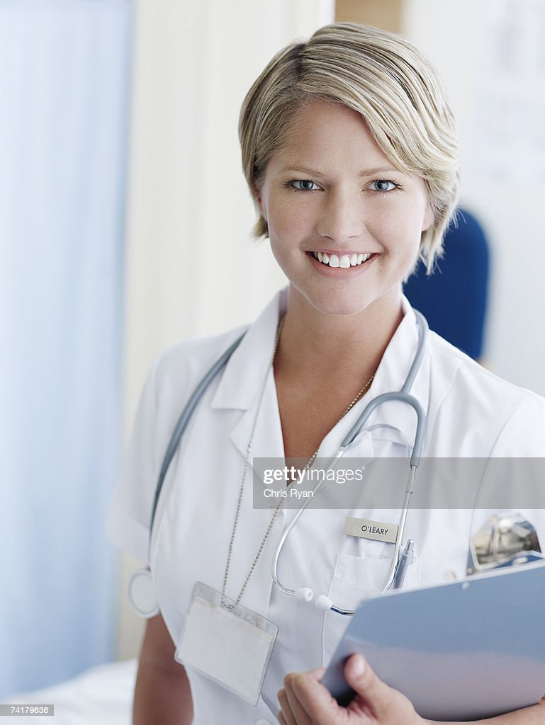 Nurse with clipboard in hospital : Stock Photo