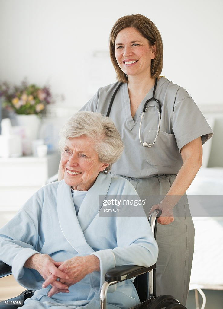 Nurse with senior hospital patient : Stock Photo