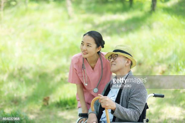 Nurse with senior man in wheelchair