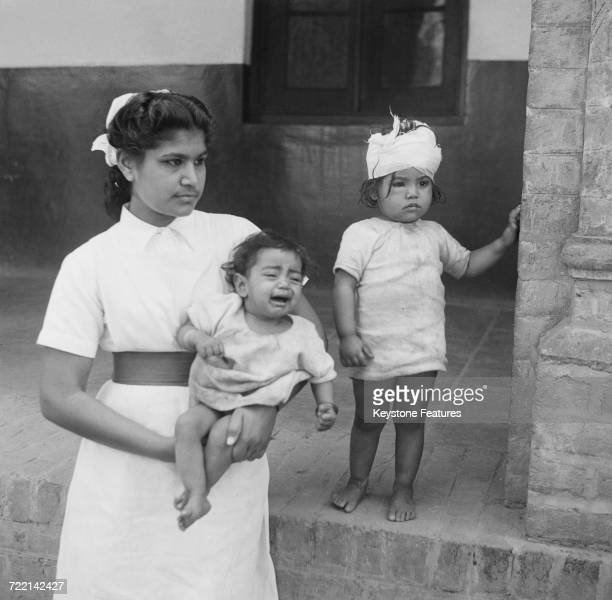 A nurse with two child victims of communal violence in Amritsar Punjab during the Partition of British India March 1947 The children's mother was...