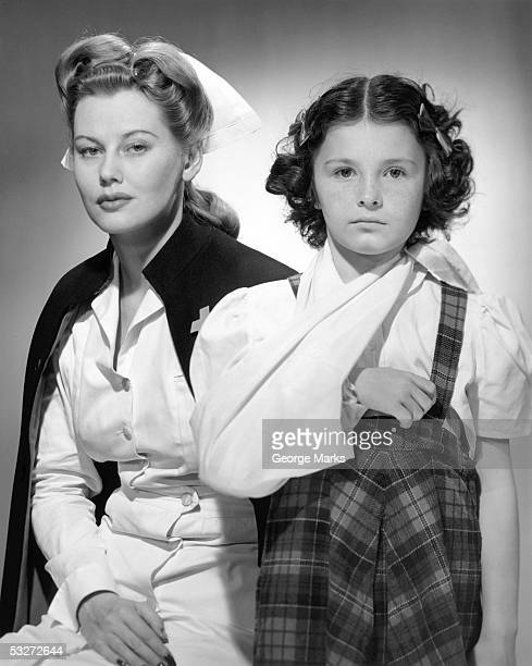 Nurse with young girl with arm in sling