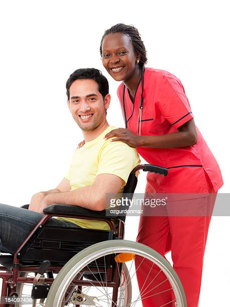 Nurse with young man in wheelchair