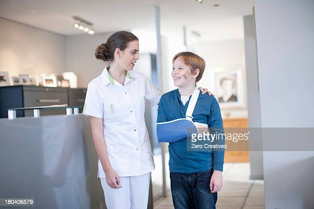 Nurse with young patient in reception