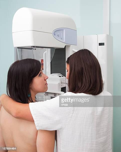 Nurse with young women having a mammogram