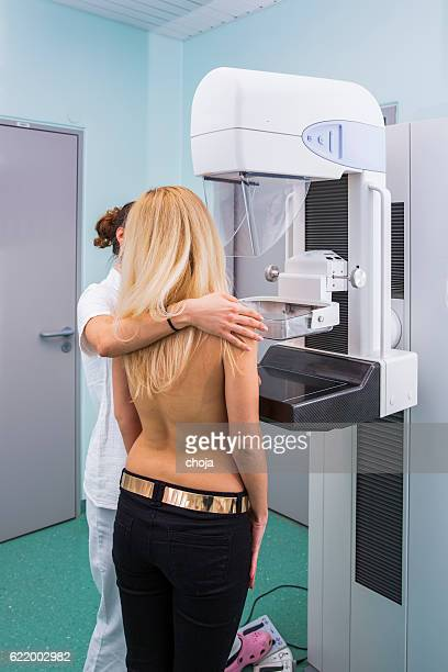 Nurse with young women having a mammography