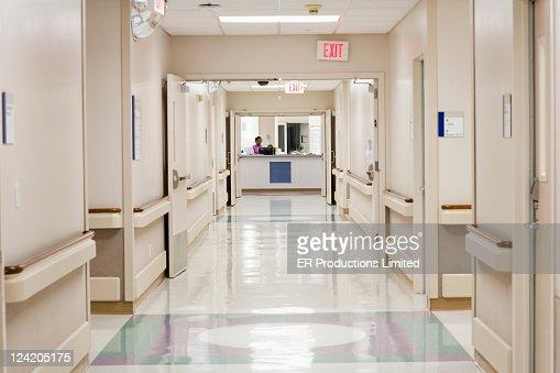 Nurse working at hospital nurses station