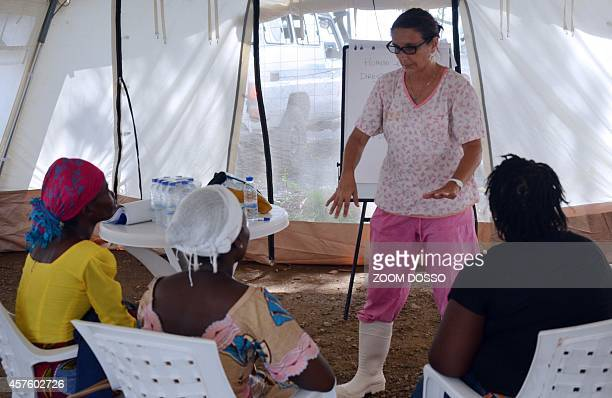 A nurse working for medical charity MSF speaks to women who survived from the Ebola virus during a training to become advisers for patients suffering...